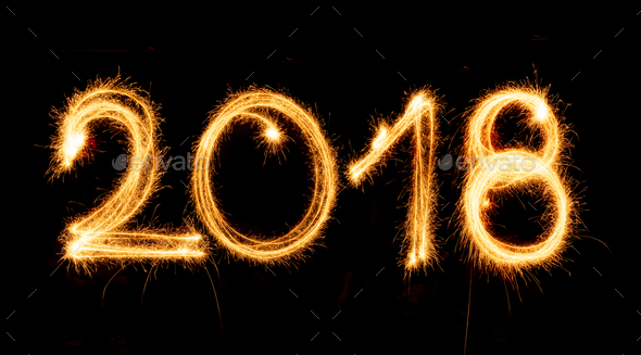2018 with sparklers on black background - Stock Photo - Images