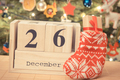 Date 26 December on calendar, gift in sock and christmas tree with decoration - PhotoDune Item for Sale