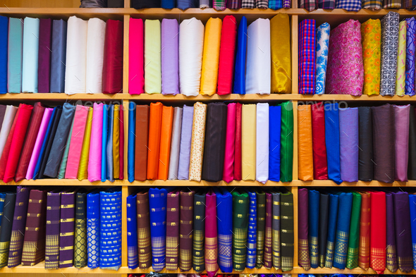 Colorful Fabrics Displayed In Shelves At Store - Stock Photo - Images