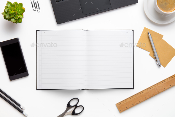 Open Diary Surrounded With Office Supplies On White Desk - Stock Photo - Images