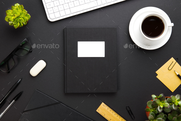 Folder With Label Surrounded By Office Supplies On Gray Desk - Stock Photo - Images