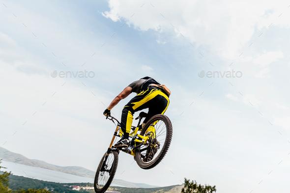 cyclist jump mountain biking - Stock Photo - Images
