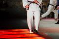 athlete judoka in white kimono