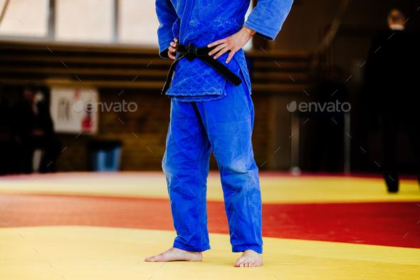 athlete judoka in blue kimono - Stock Photo - Images