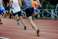 group of runners sprinters men