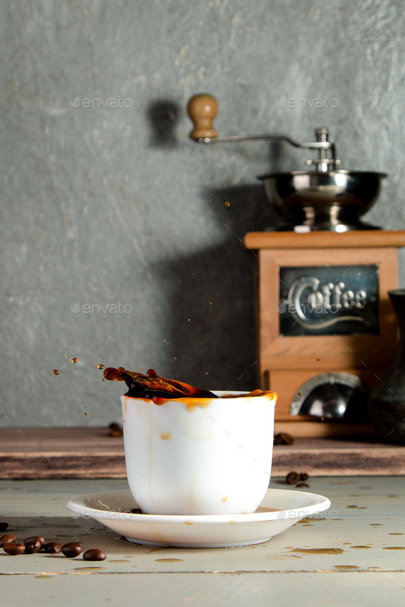 Cup of Coffee with Splash on Wooden Background with Beans. - Stock Photo - Images