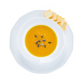 Pumpkin cream soup, view from above. With clipping path.