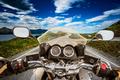 Biker rides a road with Atlantic Ocean Road in Norway. First-per - PhotoDune Item for Sale