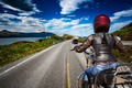 Biker girl rides a mountain road in Norway Atlantic Ocean Road. - PhotoDune Item for Sale