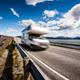 Caravan car RV travels on the highway Atlantic Ocean Road Norway - PhotoDune Item for Sale