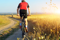 Male cyclist driving rural dirt road outdoors - PhotoDune Item for Sale