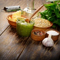 Pesto sauce ingredients and utensils on wood table - PhotoDune Item for Sale