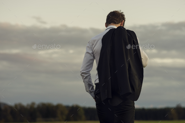 Downhearted businessman standing outdoors - Stock Photo - Images
