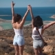 Two Happy Sisters on the Cliff Over the Sea - VideoHive Item for Sale