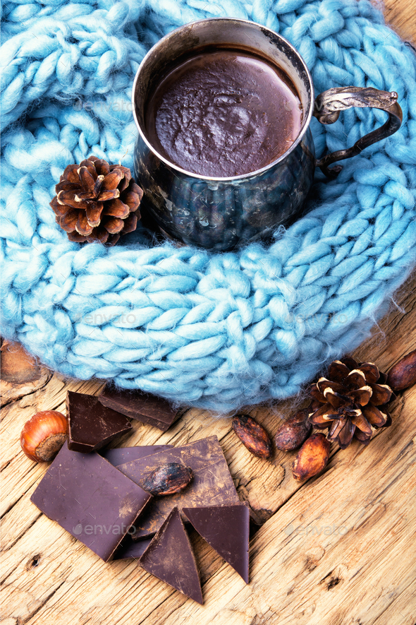 Melting chocolate in a metal cup - Stock Photo - Images