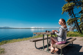 Woman tourist having a breakfast by Yellowstone Lake - PhotoDune Item for Sale