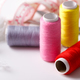 Colorful thread spools used in fabric and textile industry - PhotoDune Item for Sale