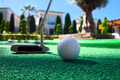 Mini golf scene with ball and club