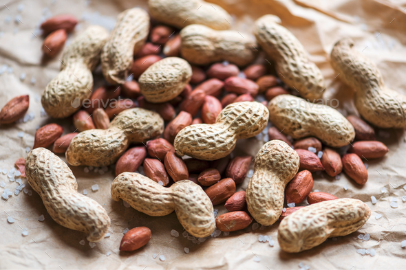 Salted peanuts on a paper bag - Stock Photo - Images