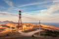 High voltage tower in mountains at sunset. Electricity pylon system - PhotoDune Item for Sale