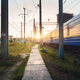 High speed passenger train in motion on railroad track at sunset - PhotoDune Item for Sale