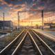 Railway station against beautiful colorful sky at sunset. - PhotoDune Item for Sale