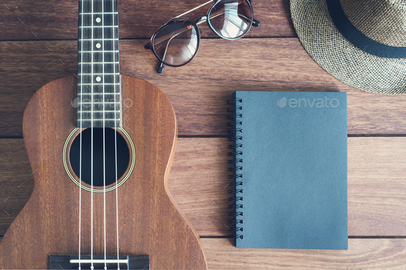 Ukulele guitar on wooden table - Stock Photo - Images