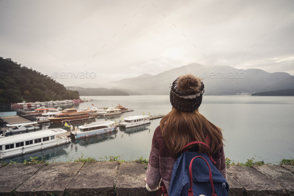 Young woman traveler looking a beautiful view at sun moon lake - Stock Photo - Images