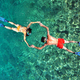 Romantic couple snorkeling in Phi Phi island, Thailand - PhotoDune Item for Sale