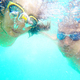 Swimming couple underwater with googles in the sea - PhotoDune Item for Sale