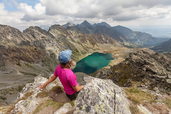 Hiking woman admiring the beauty of rocky Tatra mountains - Stock Photo - Images