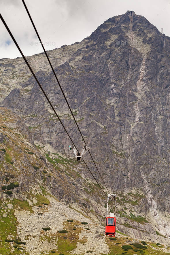 Wagon cable car against the background of beautiful rocky mountains - Stock Photo - Images