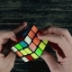 Boys Hands Solving Puzzle Cube at Dark Background. Top View - VideoHive Item for Sale