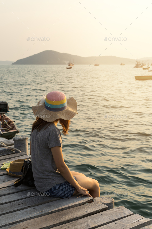 Young women traveller looking at the sea - Stock Photo - Images