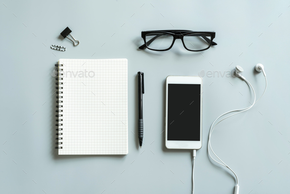 Blank notebook with cellphone desk office - Stock Photo - Images