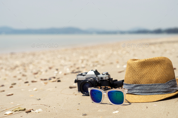 Camera, Hat and sunglasses on the beach - Stock Photo - Images