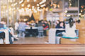 Empty wooden table space platform and blurred people reading in library - PhotoDune Item for Sale