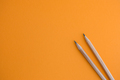Two pencils on a yellow background. - PhotoDune Item for Sale