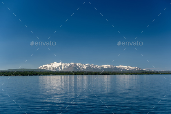 Yellowstone Lake with mountains landscape - Stock Photo - Images