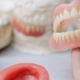 False Teeth Clicking Against the Background of Models of the Teeth - VideoHive Item for Sale