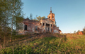 Abandoned brick orthodox church with a portico and columns at sunset - PhotoDune Item for Sale