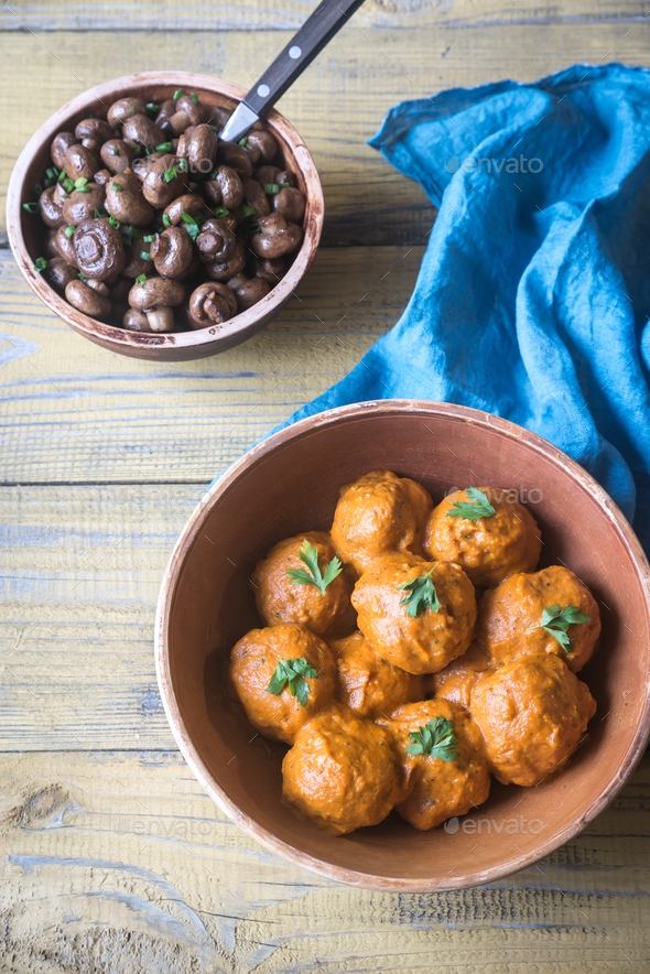 Bowl of turkey meatballs with roasted mushrooms - Stock Photo - Images
