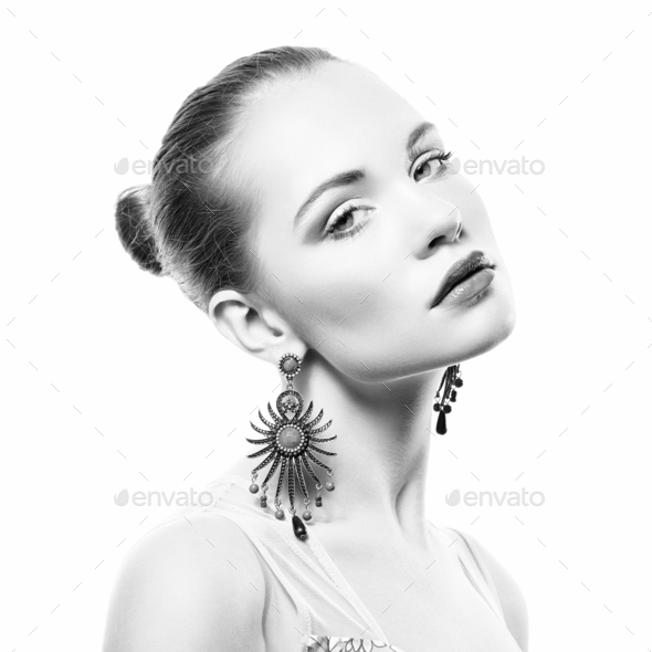 Portrait of beautiful young woman with earring - Stock Photo - Images
