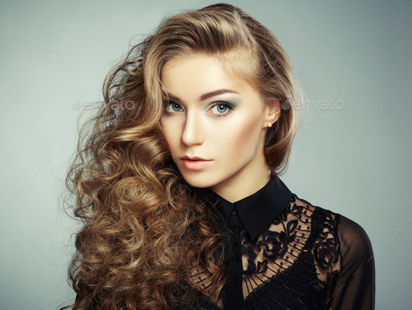 Portrait of beautiful young blonde girl in black dress. Fashion - Stock Photo - Images