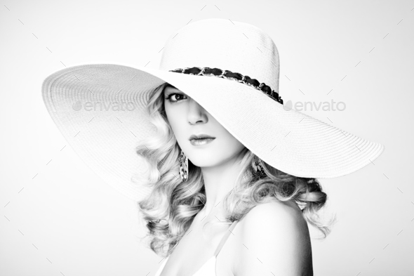 Fashion photo of young magnificent woman in hat. Girl posing - Stock Photo - Images