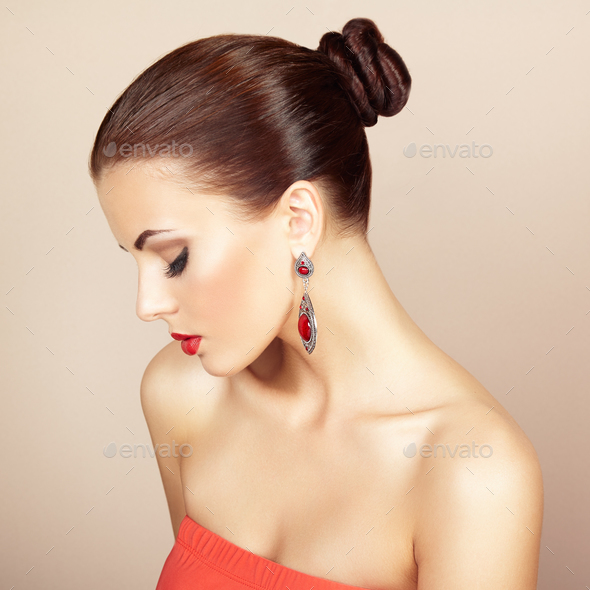Portrait of beautiful brunette woman with earring. Perfect makeu - Stock Photo - Images