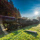 Sun rays and flare at misty morning in abandoned railway station - PhotoDune Item for Sale