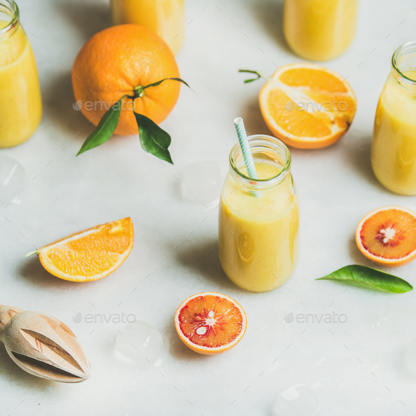 Healthy yellow smoothie with citrus fruit, square crop - Stock Photo - Images