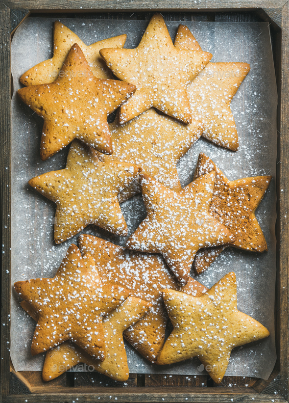 Christmas gingerbread cookies in shape of stars with sugar powder - Stock Photo - Images