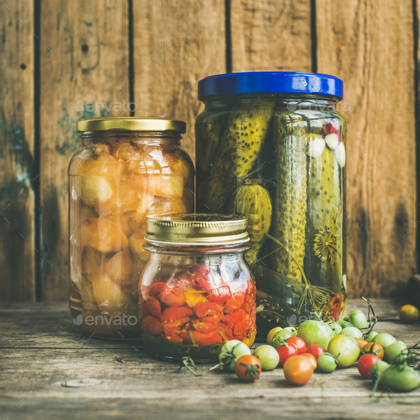 Autumn seasonal pickled vegetables and fruit in jars, square crop - Stock Photo - Images